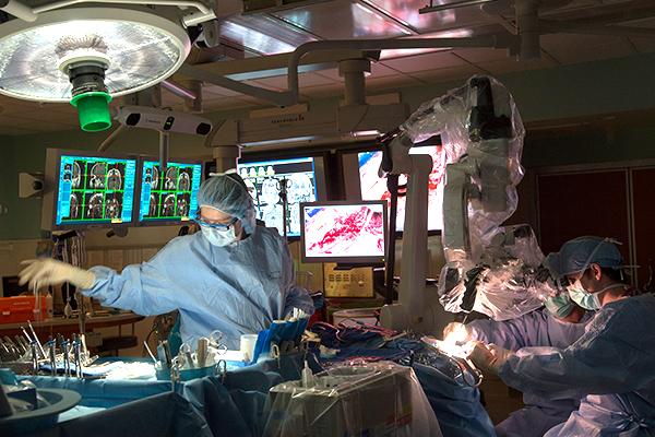 Doctors perform neurosurgery