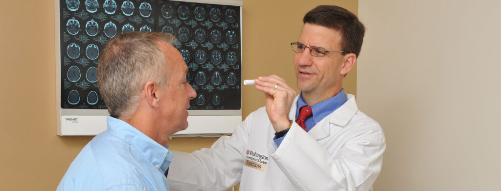 Doctor looking into eyes of patient