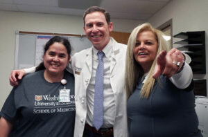 Medical Assistant Rebecca Wald-Dickler, Gavin Dunn, MD, and Deborah Nolan, RN celebrate their last day together at CAM before Nolan's retirement.